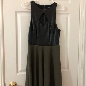 Black leather and green dress